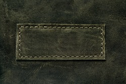 Elegant dark olive leatherette background. Leather texture. Free space for text.