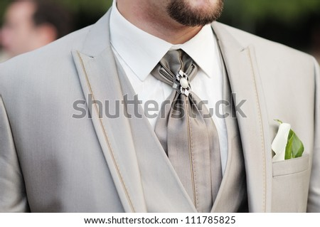 Elegant decoration on man wedding suit
