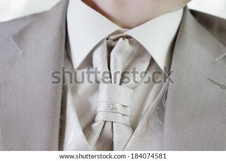 Elegant decoration on man wedding suit #184074581