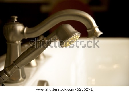 Elegant deluxe Bathtub faucets in soft dramy lighting.