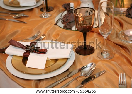 Elegant dinner in orange with blank tag on a plate - stock photo