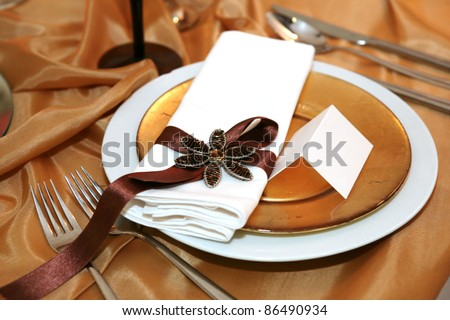 Elegant dinner in orange with blank tag on a plate