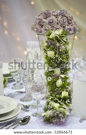stock-photo-elegant-dinner-table-with-flowers-and-glass-52866671.jpg