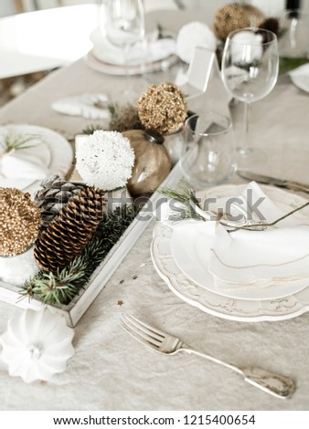 Elegant dishware and pretty New Year accessories lying on table set for holiday celebration.