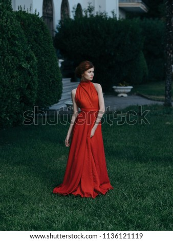 elegant elegant woman walking in the park #1136121119
