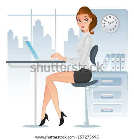 Elegant executive using her laptop in the office