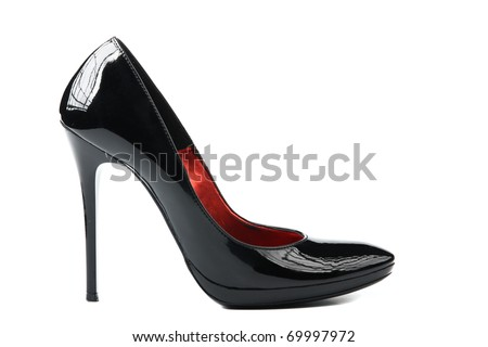Elegant expensive black high heel women shoes on white background - fetish female weapon