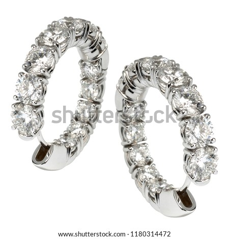 Elegant expensive diamond hoop earrings set with twin rows of faceted gemstones set in silver or platinum as a stylish accessory for pierced ears over white #1180314472