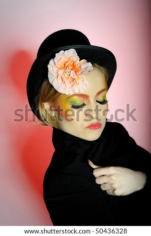 Elegant fashion woman with creative eye make-up - stock photo