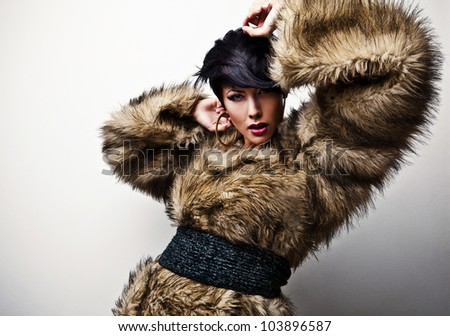 Elegant fashionable woman in fur. Fashion photo.