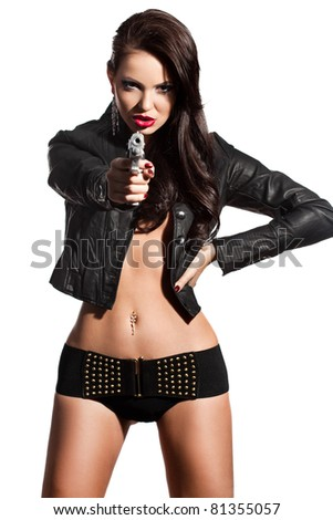 elegant fashionable woman with a pistol in hands