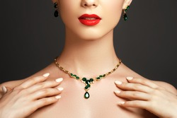 Elegant fashionable woman with jewelry. Beautiful woman with emerald necklace. Young beauty model with emerald pendant. Jewellery and accessories. Fashion and beauty salon. Perfect lip makeup