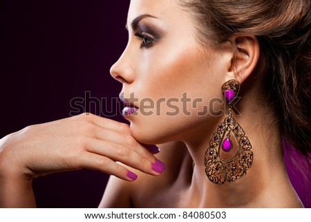 Lifestyle Stock-photo-elegant-fashionable-woman-with-violet-jewelry-84080503