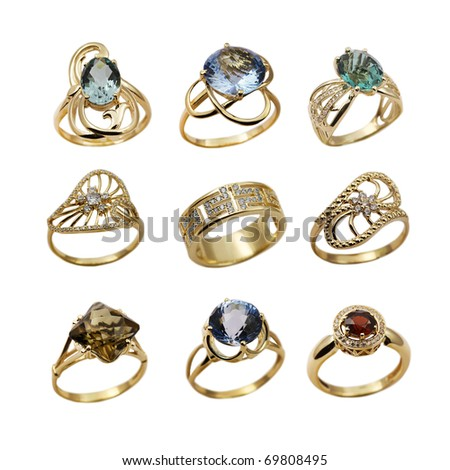 Elegant female jewelry golden  rings  isolated over white