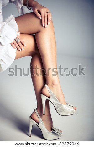 elegant female legs in high heels, studio shot