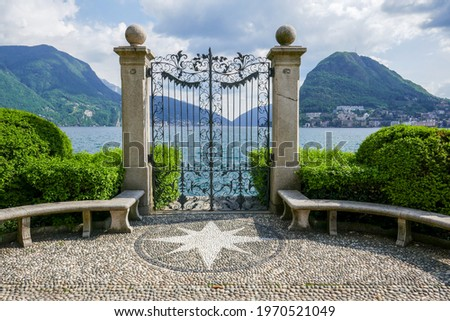 Elegant fence with round stone benches and a star shape in the mosaic stone floor (Ciani Park, Lugano, Switzerland). Zdjęcia stock ©