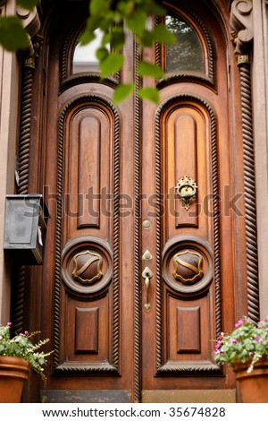 Elegant Front Doors http://www.shutterstock.com/pic-35674828/stock-photo-elegant-front-door-to-an-american-house.html