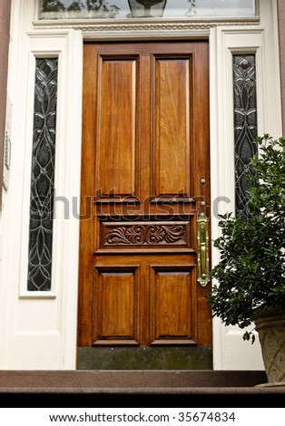 Elegant Front Doors http://www.shutterstock.com/pic-35674834/stock-photo-elegant-front-door-to-an-american-house.html