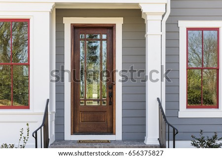 Elegant front door with iron railing #656375827