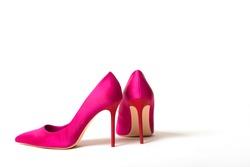 Elegant fuchsia high heel shoe on white background