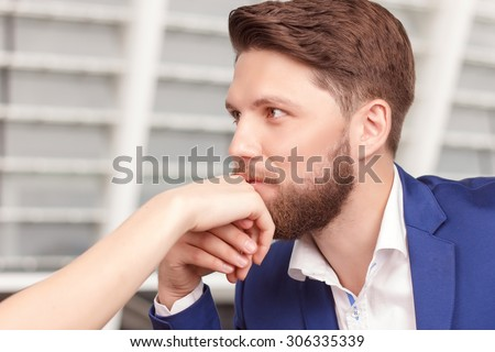 Elegant gesture. Portrait of young-looking handsome man kissing hand of his charming girlfriend