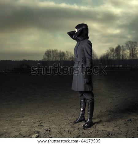 Elegant girl in black coat with high collar - stock photo