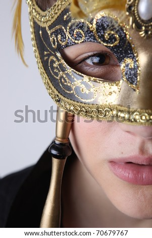elegant girl with a wonderful mask - stock photo