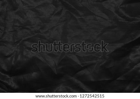 Elegant gray textile background. Silk cloth texture. Fabric pattern.
