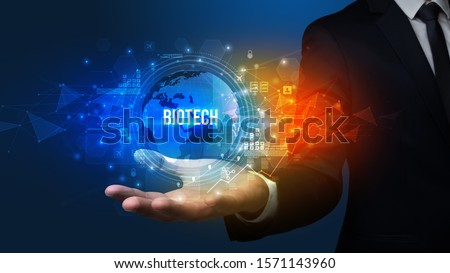 Elegant hand holding BIOTECH inscription, digital technology concept