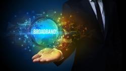 Elegant hand holding BROADBAND inscription, digital technology concept