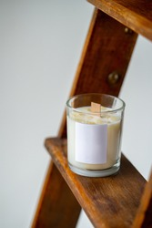 Elegant home decoration with wooden wick burning candle from soy wax with label space