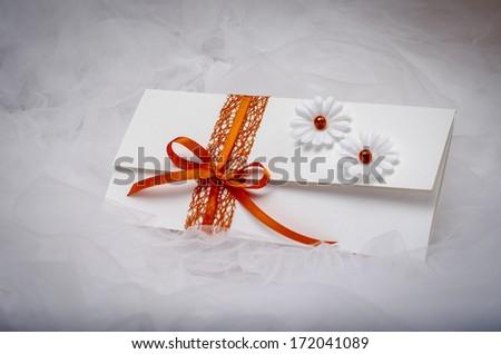 Elegant homemade wedding invitation with simple decoration.