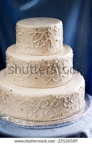 stock photo Elegant ivory wedding cake with a piped embroidered lace