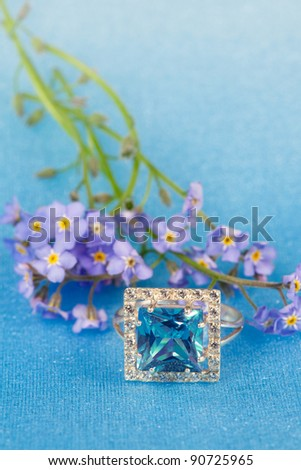 Elegant jewelry ring with spring natural flowers forget-me-not