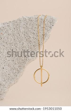 Elegant jewelry set of the gold pendant. Jewelry pendant. Product still life concept
