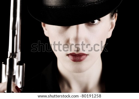 elegant lady in black holding a revolver