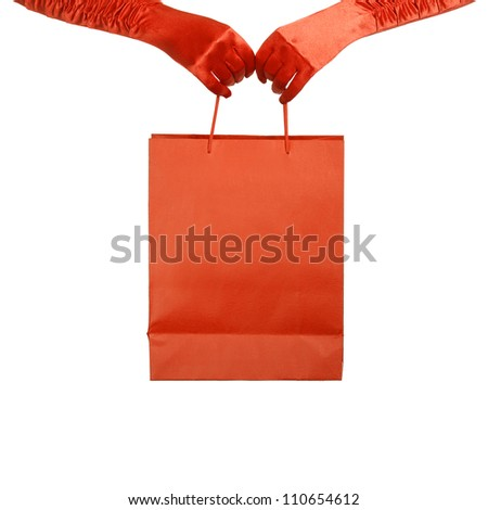 Elegant lady in red gloves holding shopping bag. Isolated over white