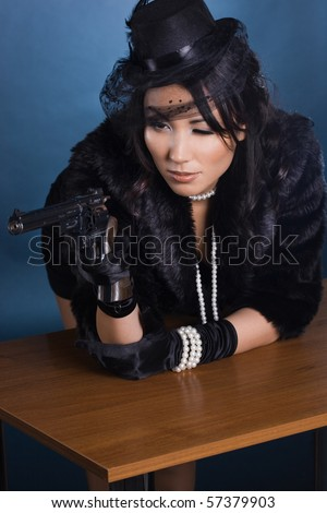 elegant lady with a pistol in hands
