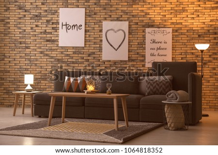 Elegant living room interior with comfortable sofa and table #1064818352