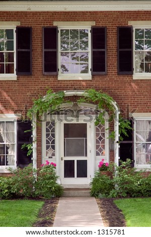 Elegant Front Doors http://www.shutterstock.com/pic-1315781/stock-photo-elegant-looking-front-door-with-an-ivy-trellis-and-flower-pots.html