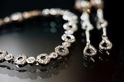 Elegant luxury bridal jewelries on dark background. Wedding details