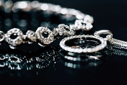 Elegant luxury bridal jewerly on dark background. Wedding details