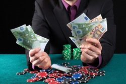 Elegant man in casino wins heap of money