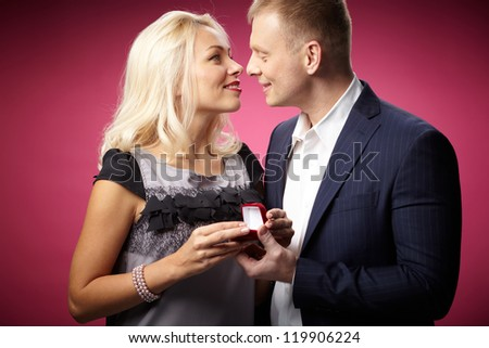 Elegant man making proposal to beautiful woman - stock photo
