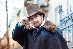 Elegant man of the nineteenth century. Vintage. in classic retro clothes, coat and hat.