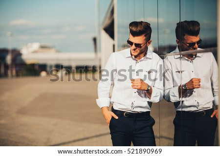 elegant man posing in white shirt and watches #521890969