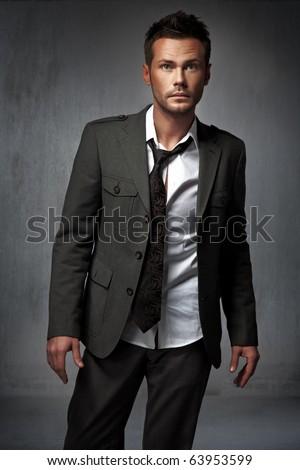 Elegant man posing on dark background