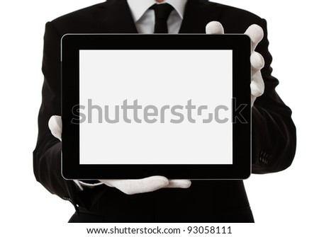 Elegant man presenting product or text on digital tablet with clipping path for the screen