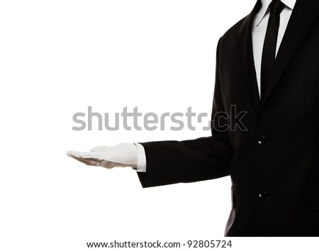 Elegant man presenting something or waiting for a tip