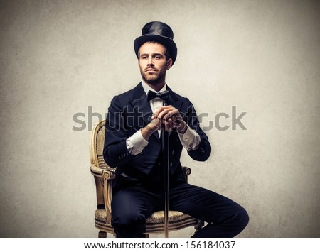 elegant man sitting on a chair...